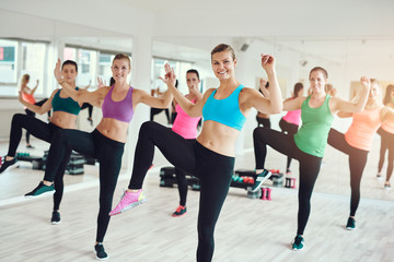 Fit young women enjoying an aerobics workout