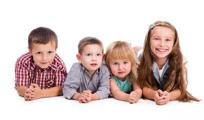 four cute children lying on the floor