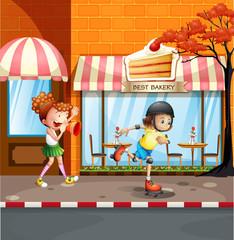 Girls playing rollerskates on the street