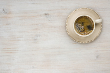 Coffee cup top view on wooden table texture background