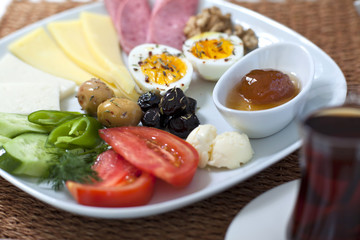 Rich and delicious Turkish breakfast on white wood table