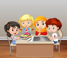 Children working in group in classroom