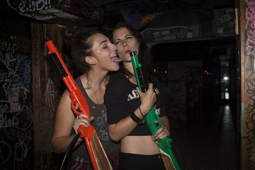 Young women playing with plastic guns