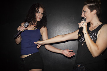 Friends doing karaoke at a nightclub