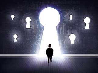 businessman looking through keyhole