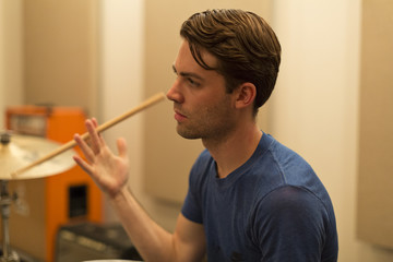 Young musician twirling a drumstick between his fingers