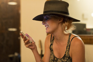 Smiling young woman checking her cell phone