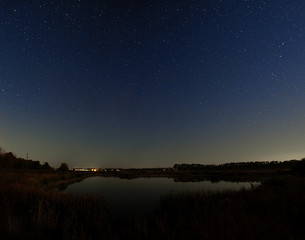 The stars in the night sky. Night landscape with a smooth surfac