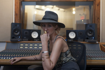 Portrait of a young woman in a recording studio