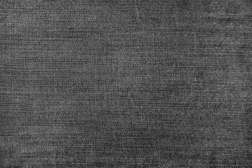 Texture of black jeans as a background