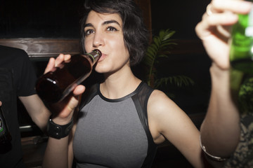 Woman enjoying beer at a party