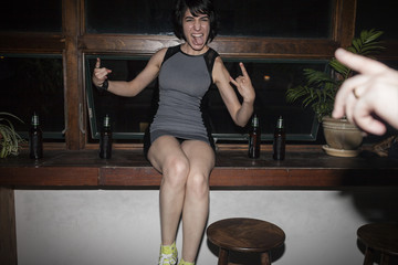 Happy young woman having fun at a party