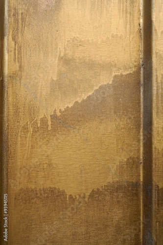Small Part Of Metal Door Sprinkled With Golden Brown Paint