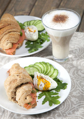 Breakfast of croissants with salmon