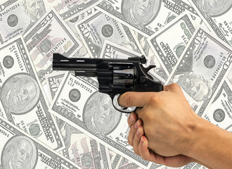 gun and money, dollars