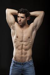 muscular torso of man on black bakground