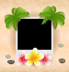 Empty photo frame with palm, flowers frangipani, sea pebbles