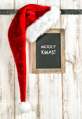 Red Santa hat and vintage chalkboard. Retro christmas decoration