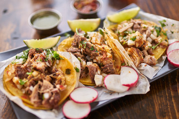 Wall Mural - three street tacos in yellow corn tortilla with different meats