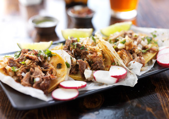Wall Mural - plate of authentic mexican street style tacos with radish slices