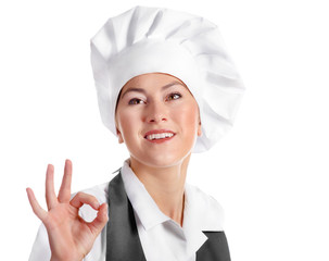young smiling woman chef isolated on a white.