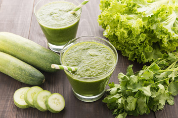 Healthy green vegetables smoothie on rustic wood table