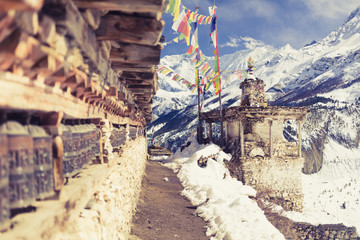 Foto auf Acrylglas Nepal Prayer wheels in high Himalaya Mountains, Nepal village, tourism travel destination