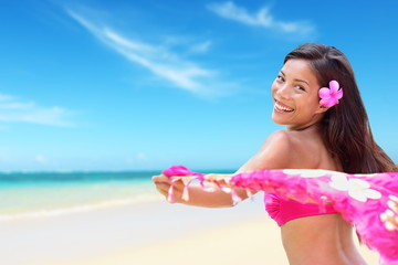 Beach woman in bikini happy on vacation