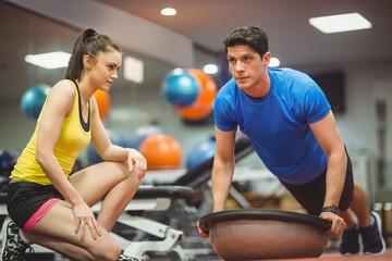 Fit woman working out with trainer