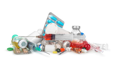 heap of medical syringes, bottles, pills, ampules isolated on wh