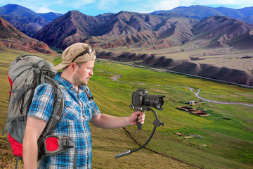 Backpacker making makes shooting of scenery landscape