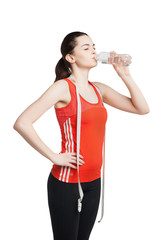beautiful woman with  measuring tape drinks water