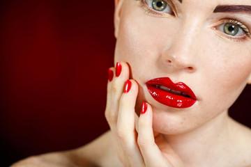 Studio portrait of a redhead female model.