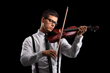 Young male violinist playing an acoustic violin
