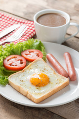 Breakfast, Egg in a hole with sausage and coffee.