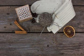Skeins of wool yarn and crochet hook. Rustic style