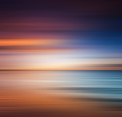 Sunset at the beach. Blurred panning motion. Abstract