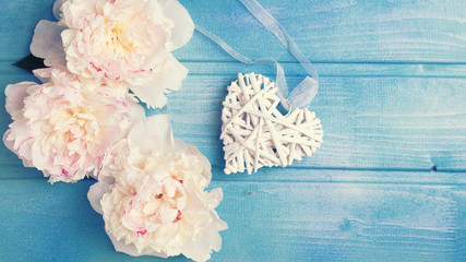 Decorative heart and  white peonies