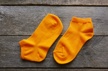 children's socks on a wooden surface