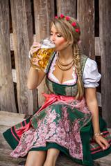Pretty young german oktoberfest blonde woman in a dirndl dress w