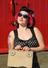 pinup girl with vintage transistor radio