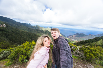 Couple taking self-portrait picture