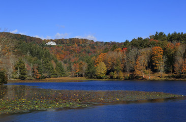 Cone Manor House near Blowing Rock, NC  in the distance with Bass Lake in the foreground