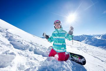 Happy snowboarder on piste