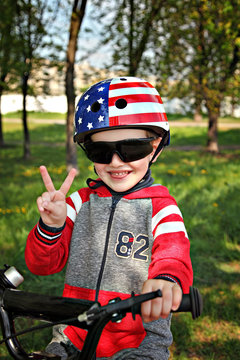 Boy with decorated hemlet on the 4th of July