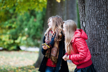 Laughing girls with the mobile phone-2