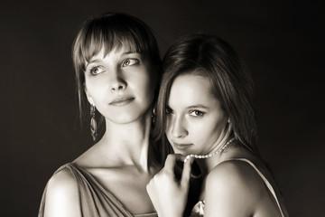 Two young happy fashion women