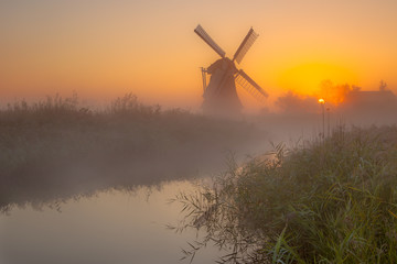 Wall Mural - Windmill in a wet polder