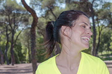 Woman is running and smiling.