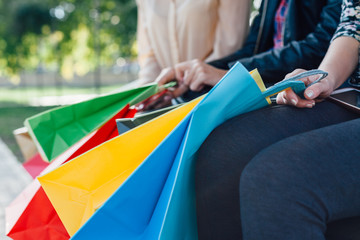 Closeup of girl with colorful shopping bags